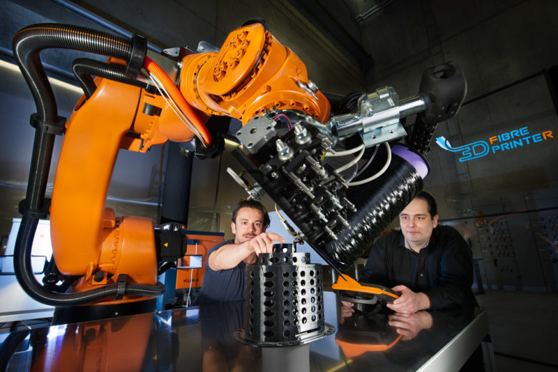 Technology photography: 3D fiber printer robot at the Fraunhofer Institute for Manufacturing Engineering and Automation IPA in Stuttgart-Vaihingen. Printing of a component made of carbon fiber for cable management in a robot.