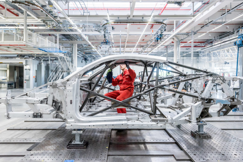 Industrial photography: Employees building an aluminum frame for a sports car.