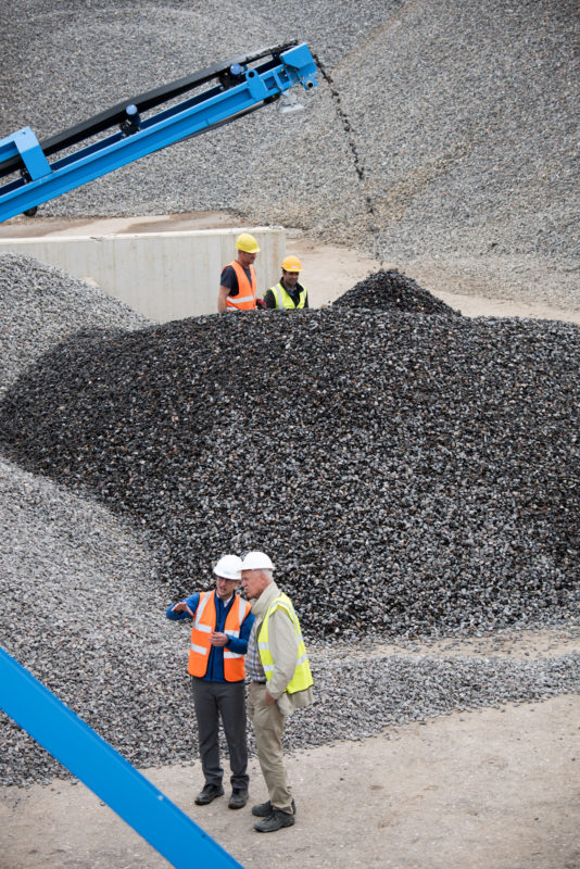 Technology photography: Modern recycling plants for building materials sort the extracted stones exactly according to size and layer the material in separate heaps.