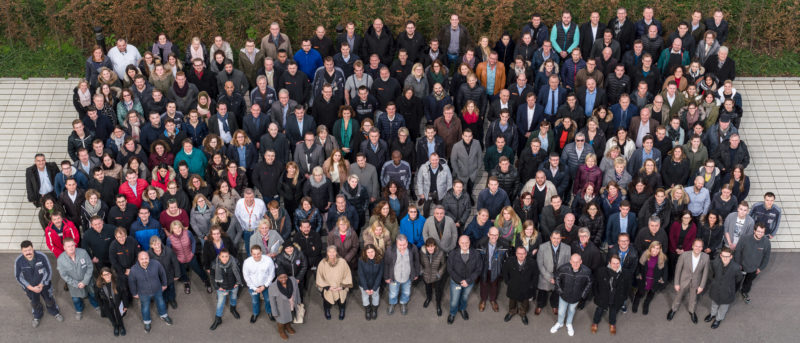 Group photo: Group picture of the entire workforce of a company. It was taken from the fifth floor of the company building and required a special aspect ratio for use in a printed product.