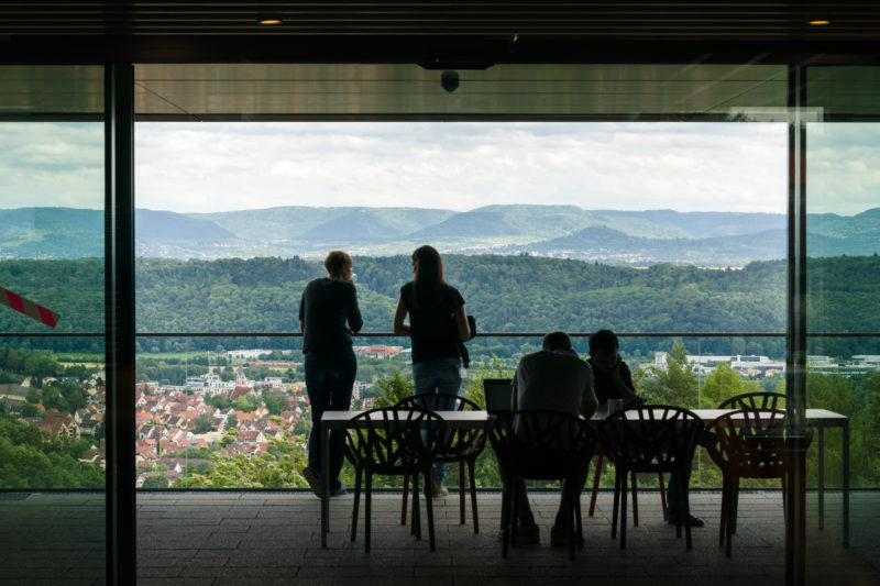 Architectural photography: Scientists in the new building of a research institute in Tübingen have a beautiful view of the wooded hilly landscape of the Swabian Alb and the city from the cafe corner.