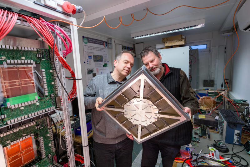 Technology photography:  Dr. johannes Schemmel and Dr. Bjoern Kindler with an insertion frame for the BrainScaleS system, a neuromorphic computer at the Kirchhoff Institute of Physics at the University of Heidelberg. The BrainScaleS architecture electronically replicates the neuronal information processing of a brain with nerve cells and their synaptic connections.