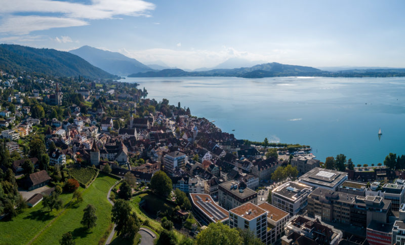 Aerial and Drone photography: Drone photo of the city of Zug at Lake Zug in Switzerland in best weather.