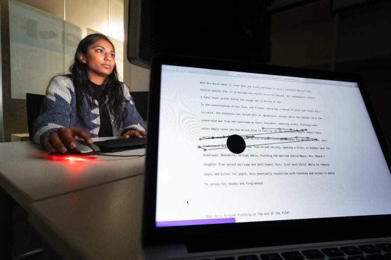 Editorial Photography: Scientist researches the interface between man and machine and the visual interaction required for this. In the foreground you can see the result of an ongoing experiment in the background. A test person reads a text and her eye movements are registered.