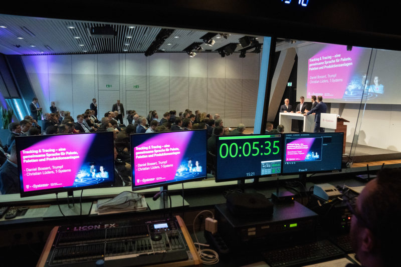 Event photography: A customer event of an IT company: A view from the control room into the event.