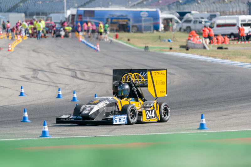 Editorial photography: Formula Student Germany: A racing car at the exit track of the speed measurement. In the background the racetrack.