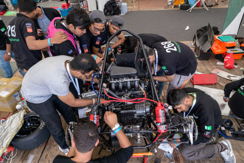 Editorial photography: Formula Student Germany: A team from Pakistan is working under high pressure in the pits on its combustion class vehicle.