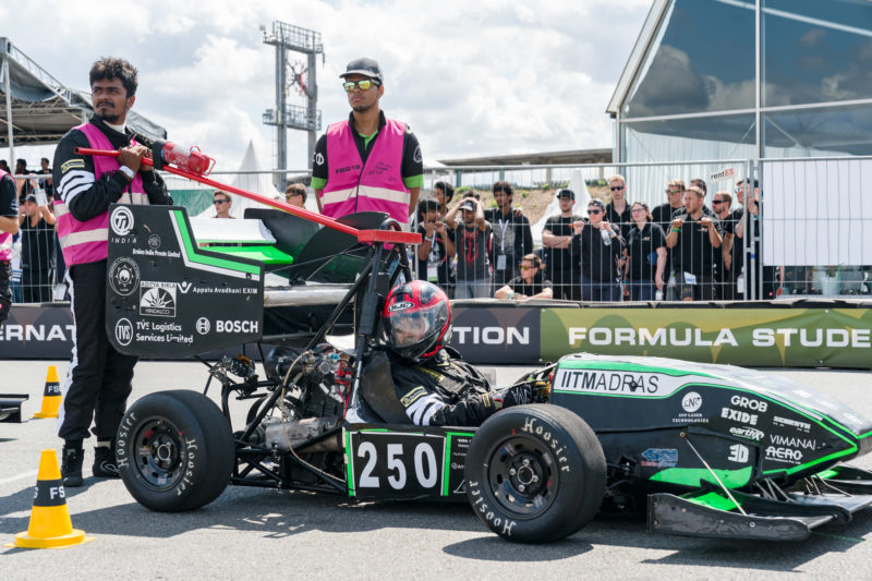 Editorial photography: Formula Student Germany: Team members of all teams look from the spectators