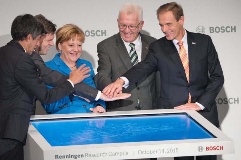 Editorial photography as event photography and fair photography: Inauguration of the research campus of Robert Bosch GmbH in Renningen with German Chancellor Angela Merkel, Bosch boss Volkmar Denner and Prime Minister Winfried Kretschmann pressing the symbolic start button.