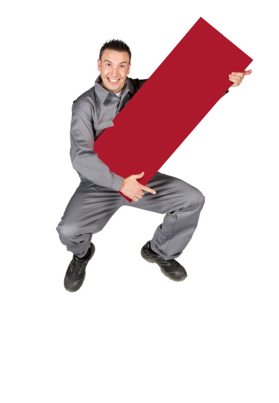 Employees photography: For a personnel campaign of a vehicle manufacturer, employees pose with a red sign against a white background. The photos are full body shots and each person acts differently in front of the camera. Here an employee in work clothes jumps into the air.