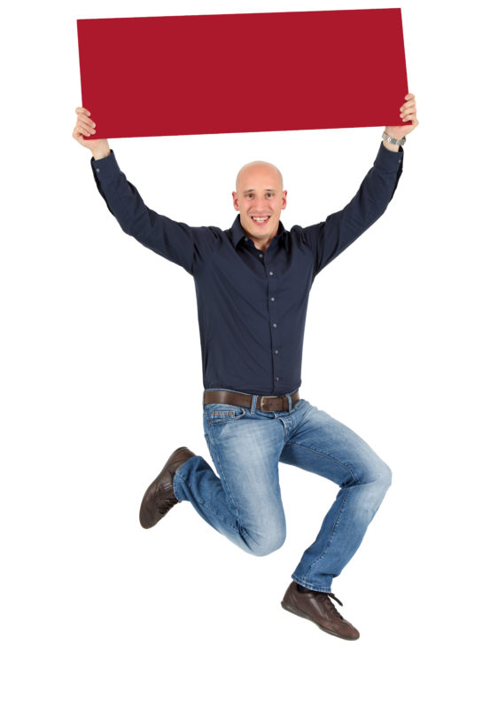 Employees photography: For a personnel campaign of a vehicle manufacturer, employees pose with a red sign against a white background. The photos are full body shots and each person acts differently in front of the camera. Here a woman just stands there relaxed. Here an employee pulls the sign into the air and jumps up.