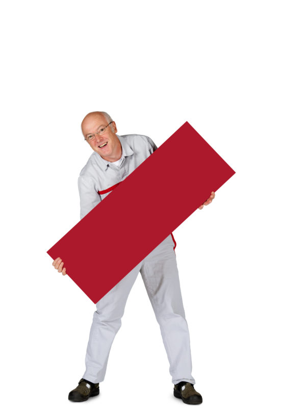 Employees photography: For a personnel campaign of a vehicle manufacturer, employees pose with a red sign against a white background. The photos are full body shots and each person acts differently in front of the camera. Here an employee holds his sign diagonally into the picture with his legs apart.