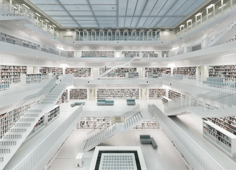 Architectural photography: Gigapixel photo of the interior of the modern city library in Stuttgart. Due to the very high resolution of the photo, which is composed of many single pictures, one can read the original titles of the books on the opposite shelves.