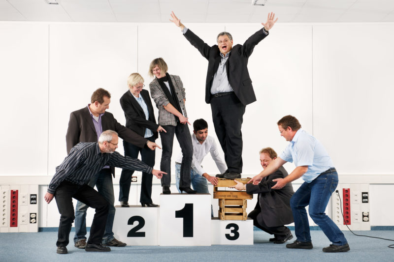 Group photo: Group photo of people on a podium.