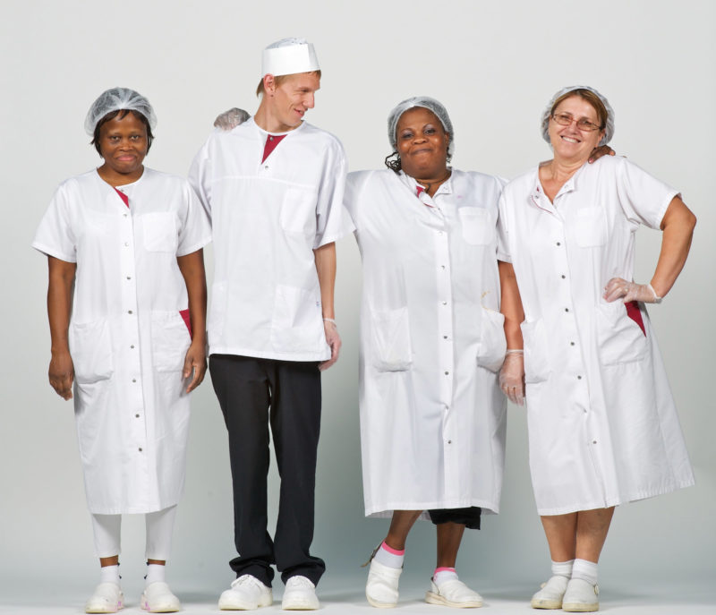 Group photo: Groupshot: House cleaners on a white background dressed in white.