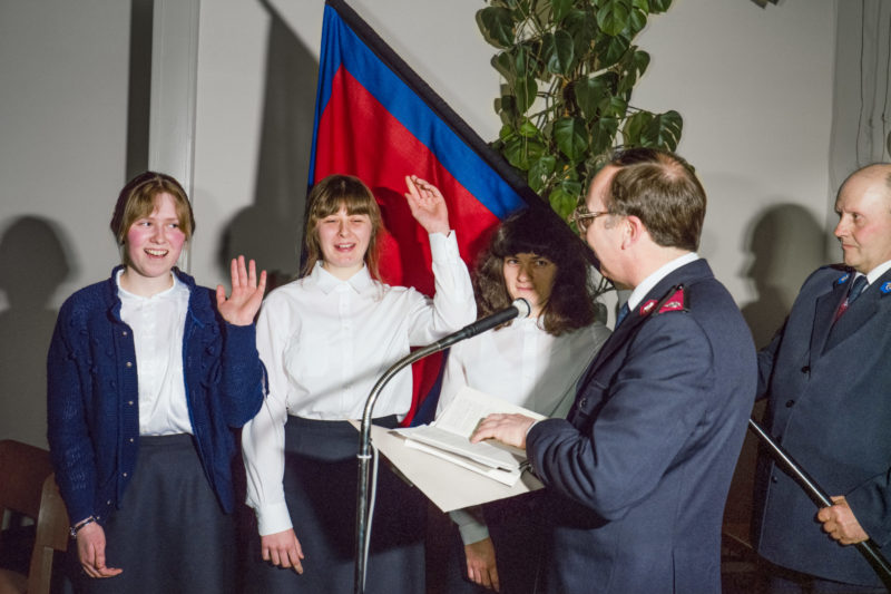 Editorial photography at the Salvation Army: Three young female cadets take the oath of allegiance to the Salvation Army.