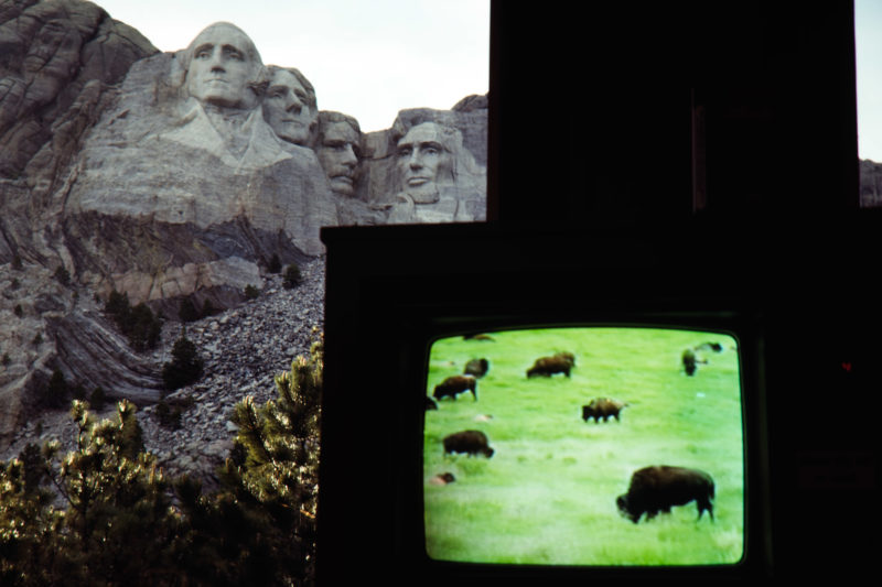 Reportage photography on slide film in the Pine Ridge Reservation in South Dakota, USA: In the visitor center of the Mount Rushmore National Memorial a video is running, which reminds of the many buffalo herds in the prairie