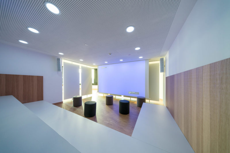 Architectural photography:  In a modern office building, there are interestingly designed rooms that are designed to promote creativity and communication. Here is a corner equipped with seats and stools, which was separated from the passage behind by movable walls.