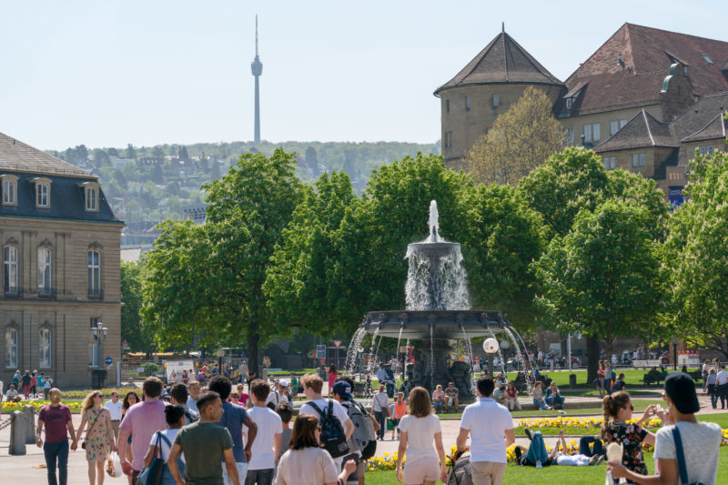 Landscape photography: Summer city view from Stuttgart: View from the Schlossplatz over one of the fountains and the Alter Schl0ß to the television tower in the background.