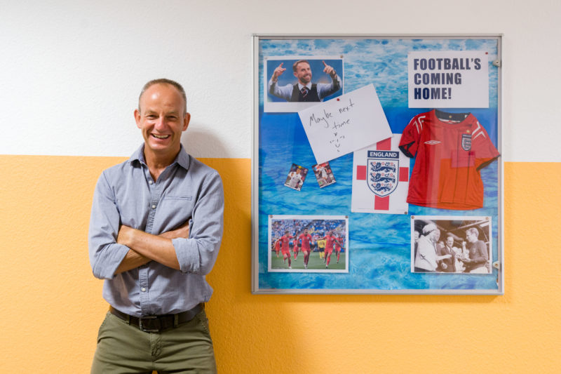 Editorial photography: A teacher at work: A collage on English football is hanging in the school corridor for English lessons