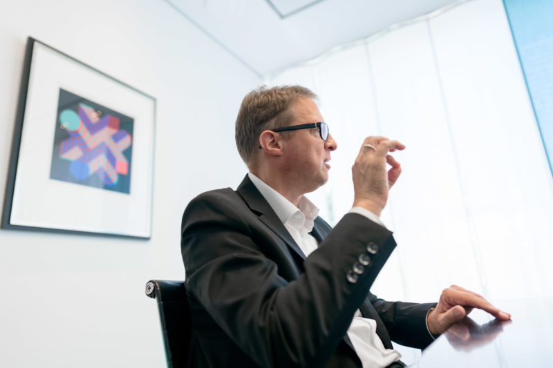 Portrait photography - Portrait of a manager of a large software company: Unusual camera angles make the photo series interesting, although only the same person is shown.