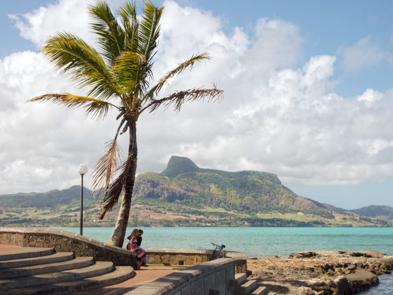 travel photography: Mauritius: A couple is sitting at the port of Grand Port. In 1810 there was a naval battle here between England and France.