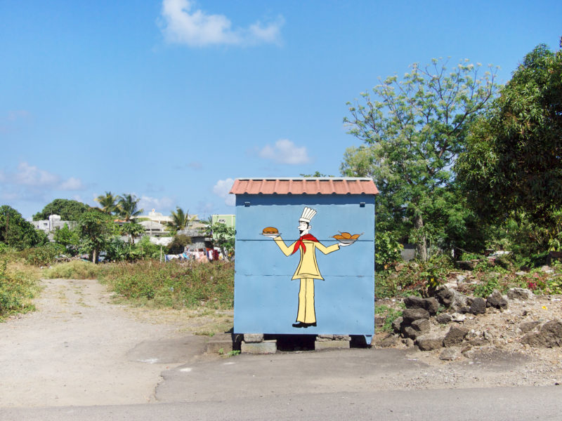 travel photography: Mauritius: A closed snack bar on a street in the country.