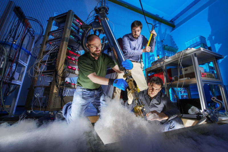 Science photography: Three scientists bring a graphene sample in a cryostat where it is examined at 0.005 degrees above absolute zero temperature for their electrical properties.