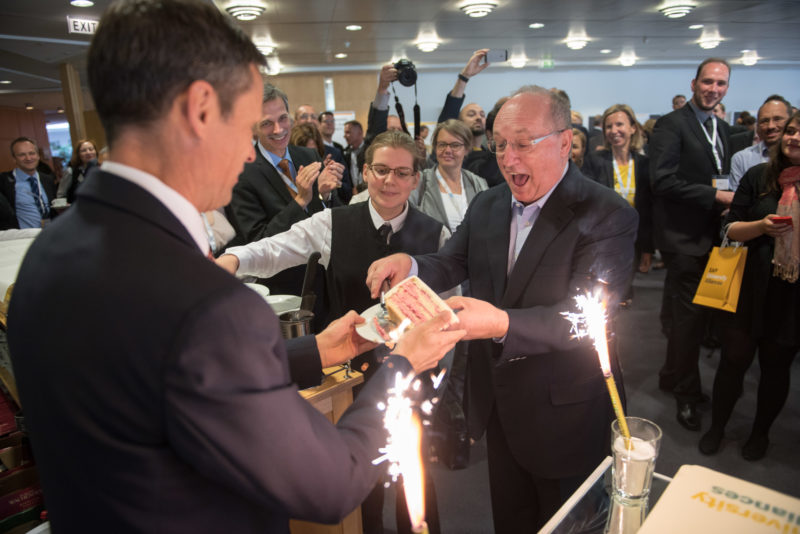 Editorial photography as event photography and fair photography: Gerhard Oswald, a long-standing member of the Executive Board of SAP SE, receives the first piece of the cake at a company event.