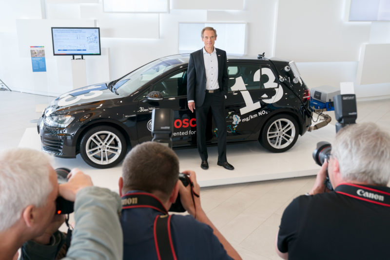 PR photography: Press photos at the press conference of Robert Bosch GmbH: Managing Director Volkmar Denner poses in front of a very environmentally friendly diesel vehicle for the photographers.