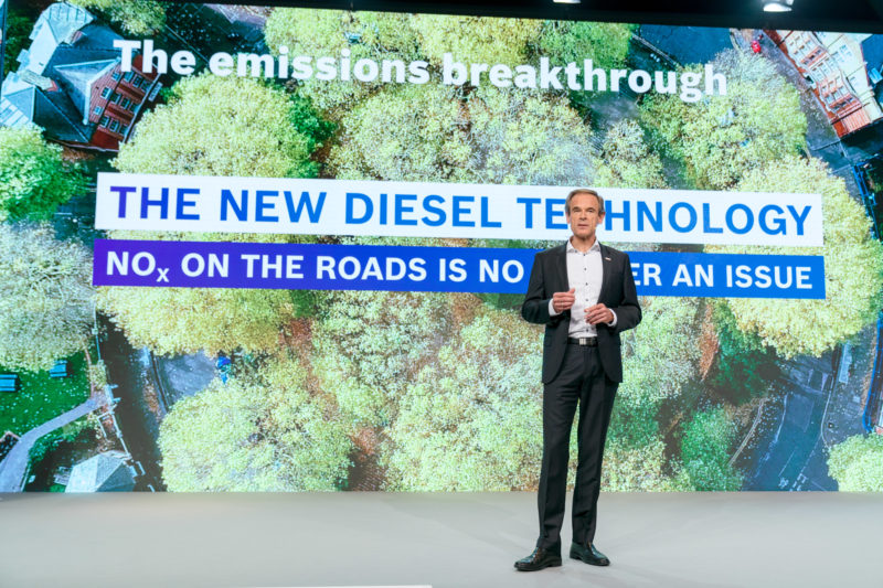 PR photography: Press photos at the press conference of Robert Bosch GmbH: Board of Management member Dr. Volkmar Denner during his presentation. In the background, the lettering The new Diesel technology.