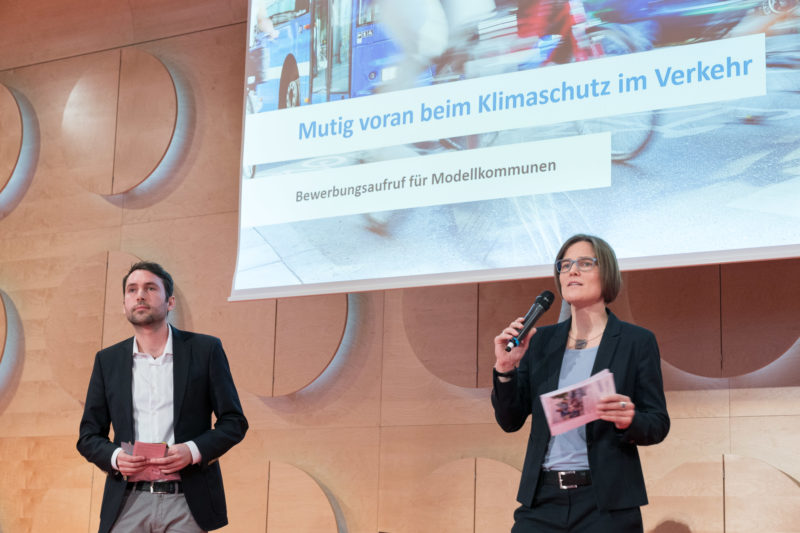 Press photos for an initiative of the Baden-Württemberg state government on the occasion of the kick-off event of the competence network CLIMATE MOBILE with Transport Minister Winfried Hermann: Several people on stage offer varied perspectives.