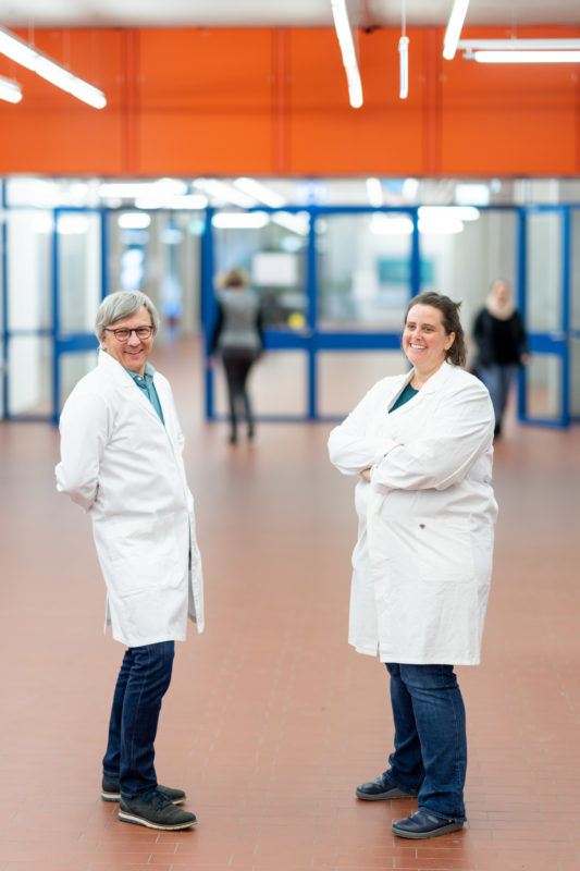 Reportage photography: Scientists create artificial ivory: they stand in white lab coats in the hallway of the institute and rejoice.