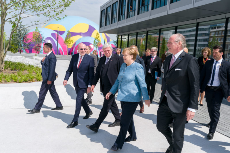 editorial photography:  German Chancellor Angela Merkel at the celebration of the 350th anniversary of Merck in Darmstadt. The VIP guests go on a tour of the company together with her. In the background the extravagant marquee.