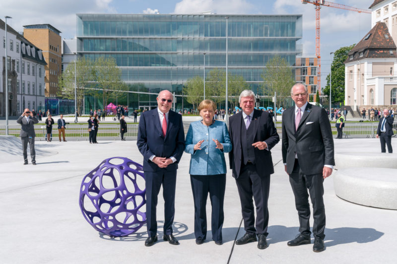editorial photography: German Chancellor Angela Merkel at the celebration of the 350th anniversary of Merck in Darmstadt. The hosts stop with her for a group photo in front of the company headquarters.
