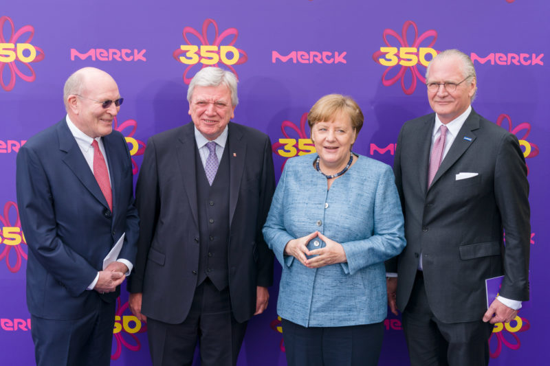editorial photography: German Chancellor Angela Merkel at the celebration of the 350th anniversary of Merck in Darmstadt. The hosts and Hessian Prime Minister Volker Bouffier at the group photo against the VIP photo background.
