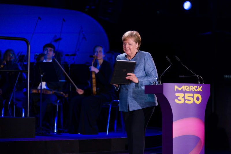 editorial photography: German Chancellor Angela Merkel at the celebration of the 350th anniversary of Merck in Darmstadt. After her speech she leaves the podium.