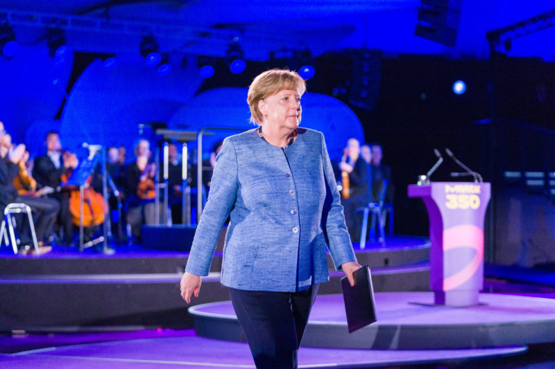 editorial photography: editorial photography: German Chancellor Angela Merkel at the celebration of the 350th anniversary of Merck in Darmstadt. After her speech, she returns to her seat in the audience.