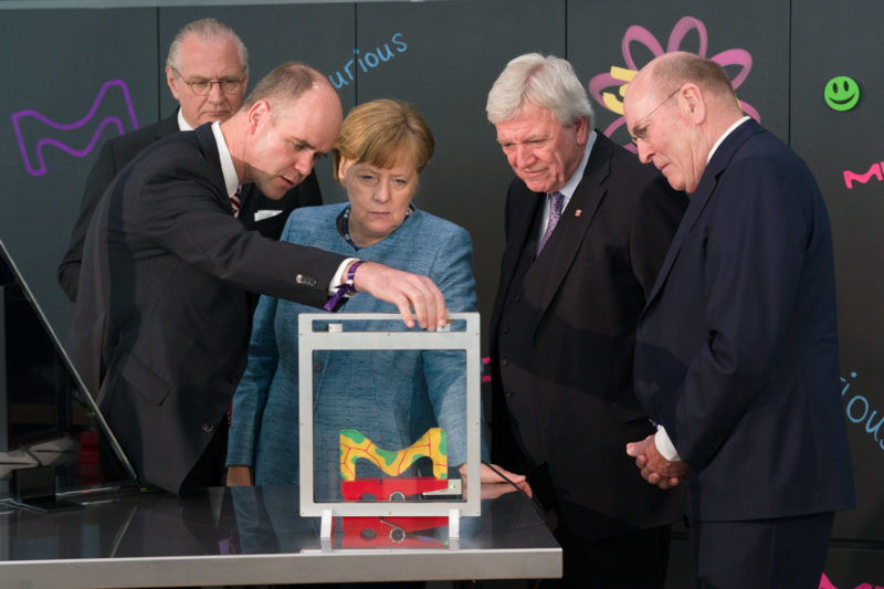 editorial photography: German Chancellor Angela Merkel at the celebration of the 350th anniversary of Merck in Darmstadt during a technical demonstration.