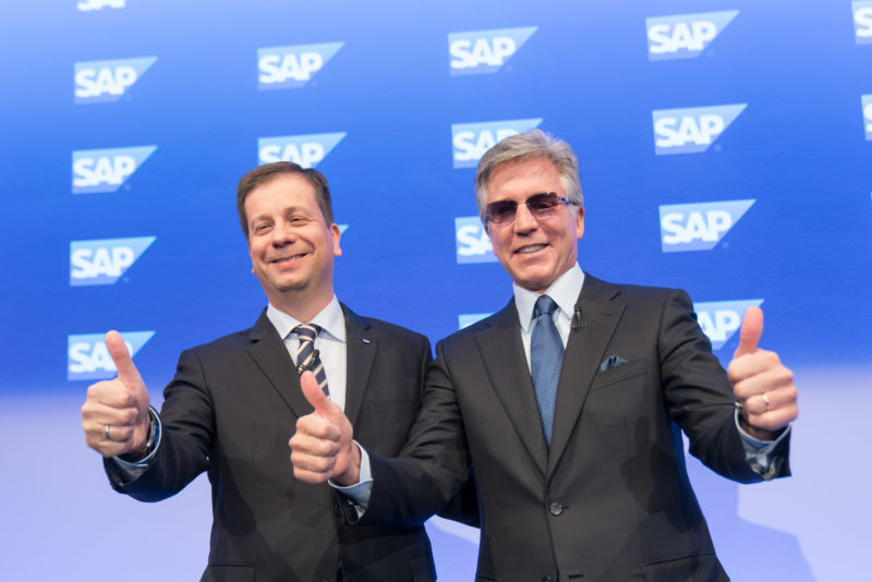 Editorial photography as event photography and fair photography: SAP SE Annual Press Conference in Walldorf: CEO Bill McDermott and CFO Luka Mucic raise their fingers.