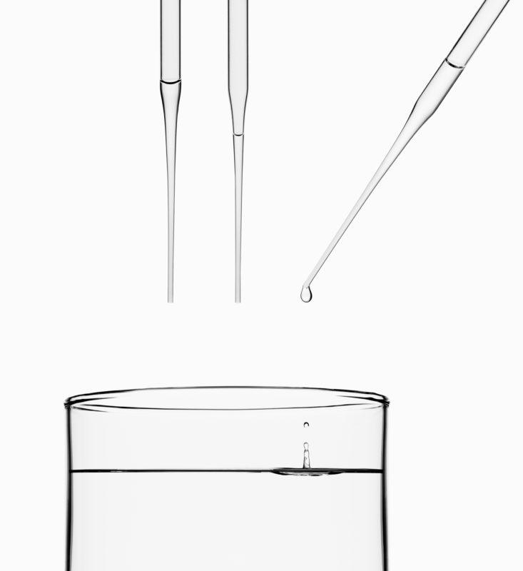 Studio photogaphy: Studio photography: Water dripping from a glass pipette.