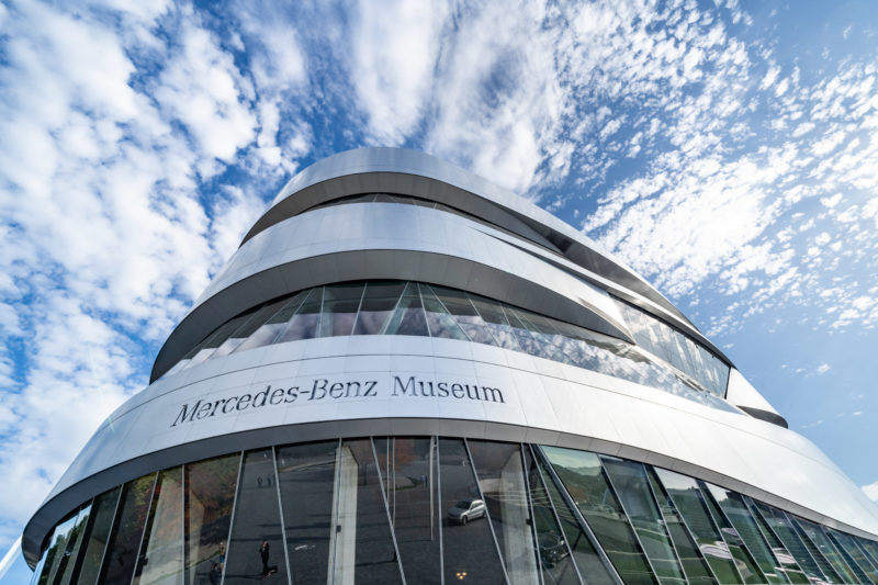 Portrait of Stuttgart: The Mercedes-Benz Museum with its modern architecture against a blue cloudy sky.