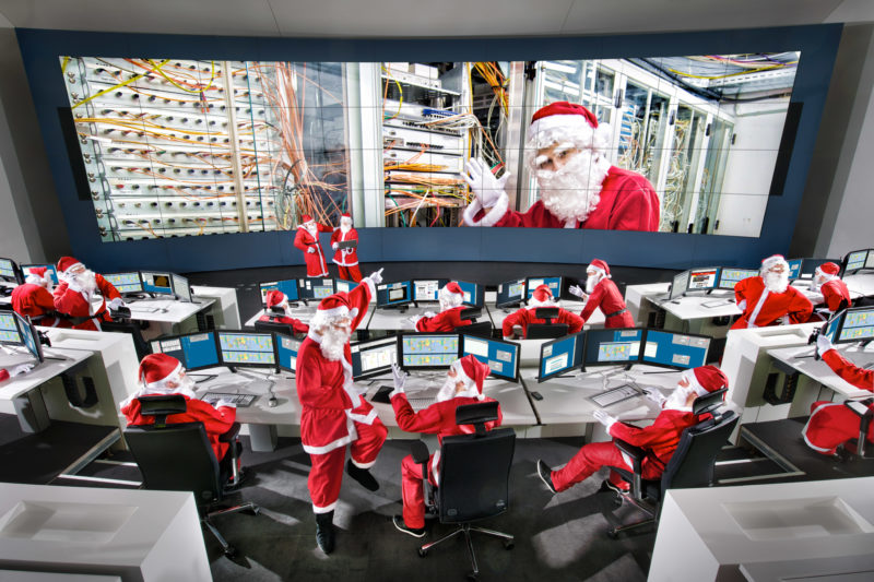 Photo montage: Santas in their control center.