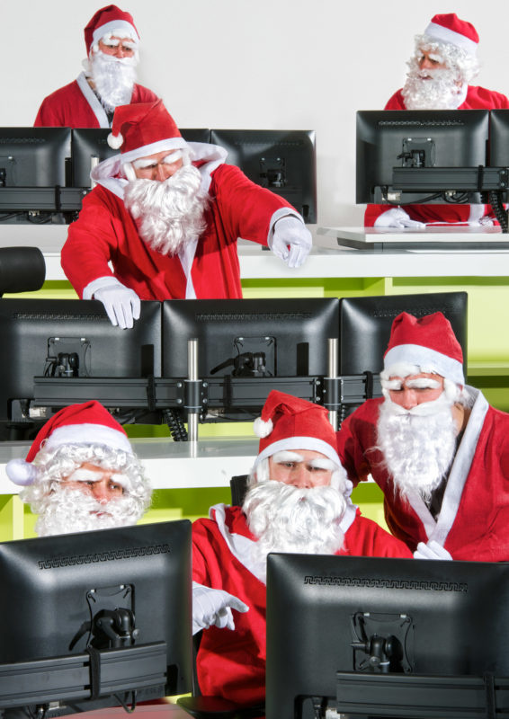 Photomontage with Photoshop: Santas in their control center.