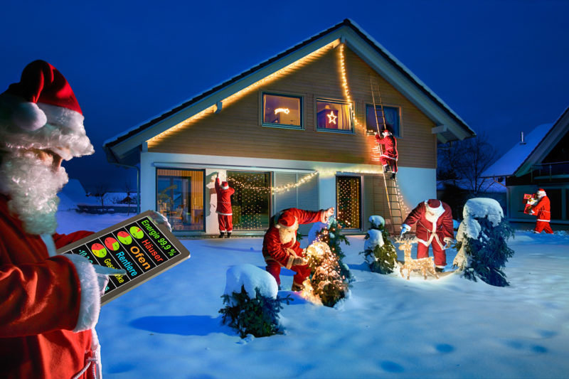 Photomontage with Photoshop: Symbolic image for cloud computing for Christmas: Santa Claus adorn a house and get the latest information from the cloud.